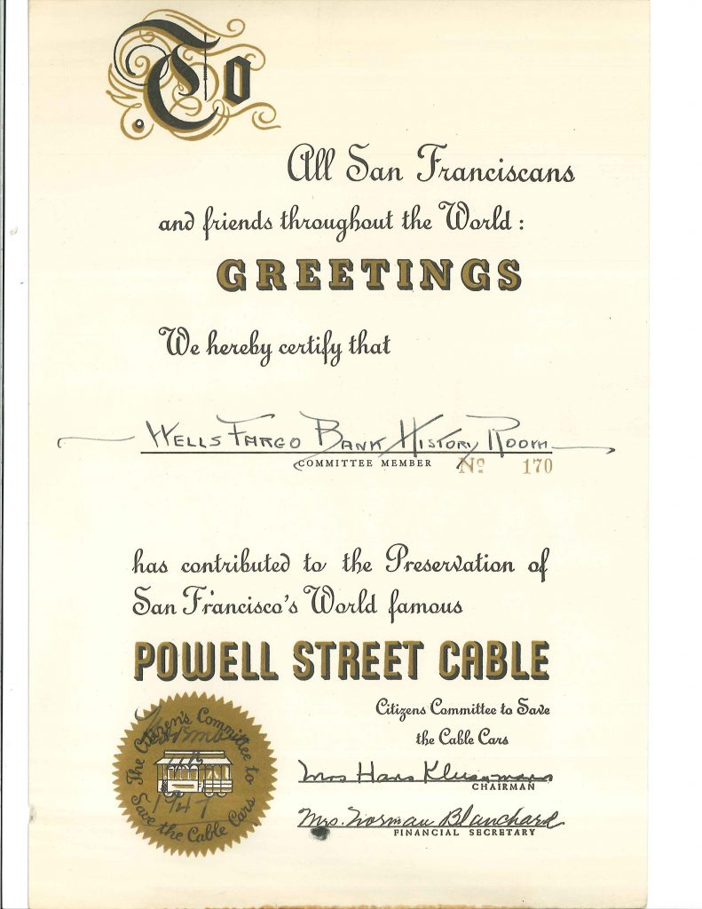 A paper says: All San Francisco and friends throughout the World: Greetings. We hereby certify that Wells Fargo Bank History Room has contributed to the Preservation of San Francisco's World famous Powell Street Cable.